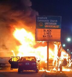 Bradford Community Church Unitarian Universalist in Kenosha with Black Lives Matter on their sign in front of flames from rioting after the shooting of Jacob Blake